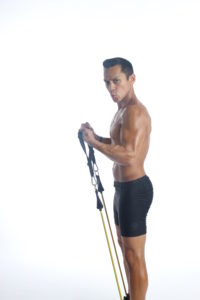 personal trainer Tony Arreola performing a full body exercise